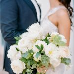 bride and groom first look with white bouquet from Elegant Fusion Wedding
