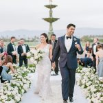 Newlywed recessional in the round bride and groom floral aisle Empire Polo Club Elegant Fusion Wedding