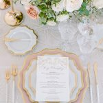 white and pink tablescape design place setting menu from elegant fusion wedding
