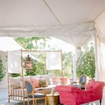 Wedding lounge furniture with colorful pillows and Moroccan lantern at Empire Polo Club elegant fusion wedding