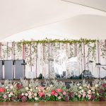 Colorful band stage decor floral for elegant fusion wedding
