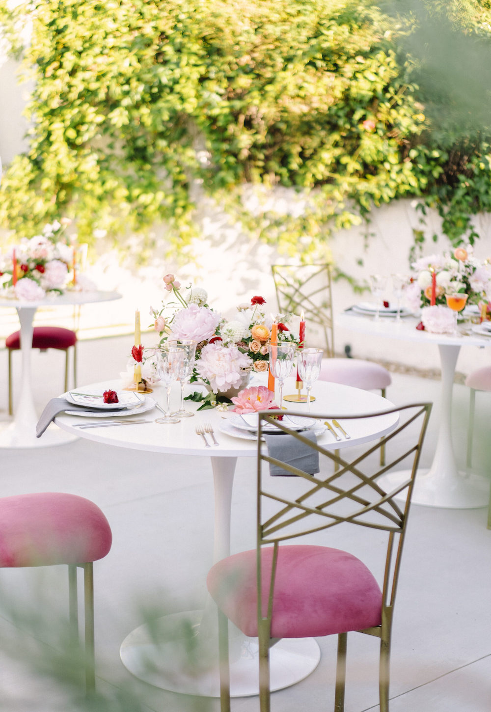 Guest seating at small tables for an intimate event.