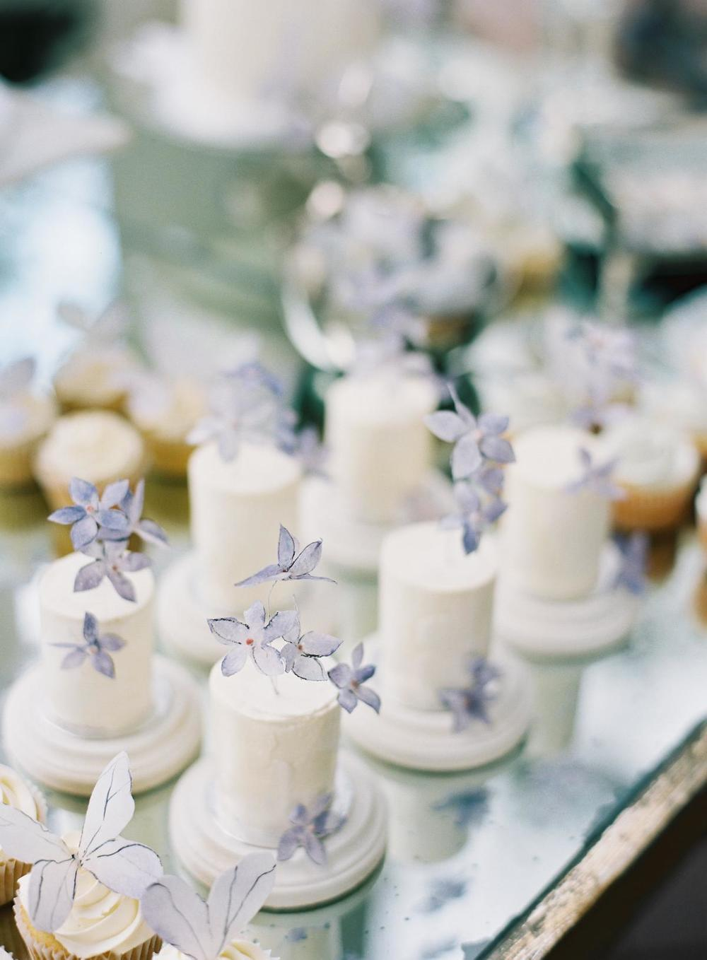 Single serving mini lakelets are garnished with delicate lavender floral.