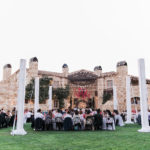 Guests sit for dinner at Sunstone Winery for this destination wedding